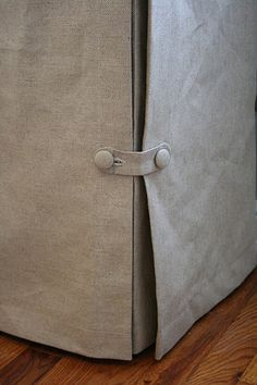 button detail on skirted table or slipcovered chair