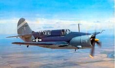 A USN Curtiss SB-2C Helldiver in a tricolor scheme and tail markings of VB-80 Bombing Squadron which operated off the aircraft carrier USS Hancock (CV-19).