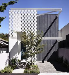 Perforated bricks soften the facade and provide privacy for the owners of this Melbourne house by Australian studio Inglis Architects