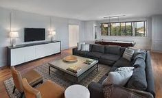 grey sofa with brown leather chair - Google Search