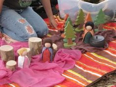 Using peg dolls and other items to create scenes and act out stories.  A great way to develop fine motor coordination and help visual learners with storytelling.