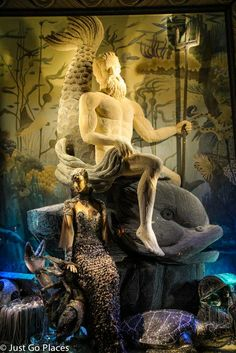 A window display at Bergdorf Goodman, a luxury store in NYC with a jewelled mermaid and a Poseidon made of pearls.