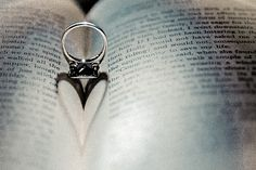 Engagmenet or wedding photo using ring in the fold of a book. light from above and behind will create heart shaped shadow.
