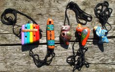 6 hole brightly coloured 'pan-pipe' ocarina from Peru