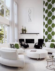 In this living area, Rolf Benz armchairs from Carriage House in black Bergamo fabric contrast the white furnishings and shag carpet. Interior designer Joseph C. Fava used gauzy Rodolph fabric from Jerry Pair for the draperies.