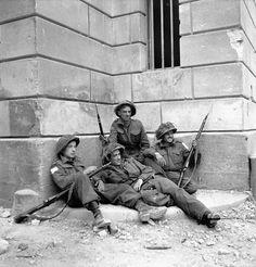 Infantrymen of The Highland Light Infantry of Canada having a rest, Caen, France, 10 July 1944.