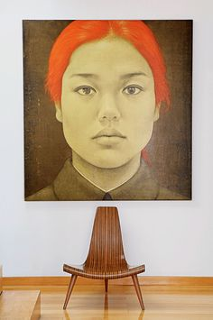 ♂ Bold symmetry interior design idea. Simple chair with a huge contemporary wall art of red hair woman portrait
