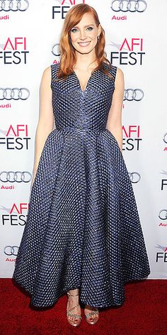 At first this seems just like a simple, ladylike, retro silhouette, but the Roksanda dress Jessica wears to the premiere of A Most Violent Year at the AFI Fest Opening Night Gala in Hollywood has an unexpected, almost reptilian texture that elevates the whole outfit. Nicholas Kirkwood sandals complete her outfit.