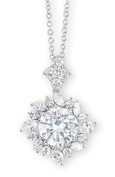 A DIAMOND PENDENT NECKLACE   Centering upon a brilliant-cut diamond weighing 4.06 carats, within a marquise and brilliant-cut diamond surround, suspended from a quatrefoil brilliant-cut diamond surmount, mounted in 18k white gold, 42.7 cm long (length adjustable)