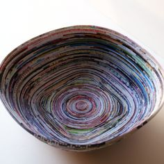Magazine Page Bowl - something to do with all those magazines! @ http://savedbylovecreations.com/2011/10/recycled-magazine-page-bowl.html