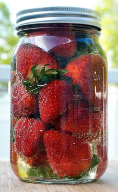 Champagne-Soaked Strawberries ~ Fill Mason jar with fresh strawberries, add champagne, cover and let fruit soak. Eat as fruit cocktail or use as garnish on drinks. As a variation, use Cruzan pineapple rum or X-Rated Fusion instead of champagne. Party Drinks, Fun Drinks, Yummy Drinks, Alcoholic Drinks, Beverages, Cocktails, Yummy Food, Smoothies, Kolaci I Torte