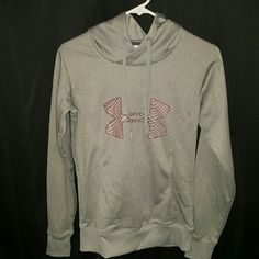 Under Armour Cold Gear Pull Over Sweatshirt Brand new without tags Under Armour sweatshirt. Never worn, semi-fitted. Gray in color with salmon/pink and dark gray in the logo on the front. I can also bundle! This would go great with a pair of dark jeans. Under Armour Tops Sweatshirts & Hoodies