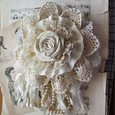 Nice idea - flower corsage made from combination of handmade fabric rose, rosette, gathered ruffles, crochet doily, ribbon and pearl strand.: