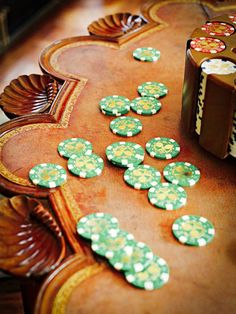 Poker chips on top of a wooden table in a casino
