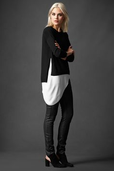EILEEN FISHER: The Long and Short of It. I like the black top. Layering over a white shirt with black tights is interesting also.