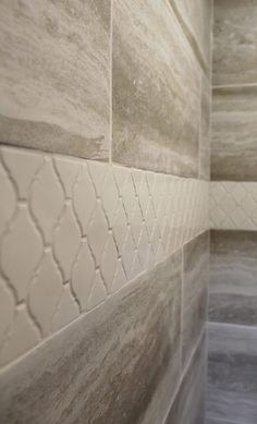 Walls: Trouve 12 x 24 Montage Grey with Warm grey grout; Accent: Keystones 2 x 2 Desert Gray, Gray Arabesque