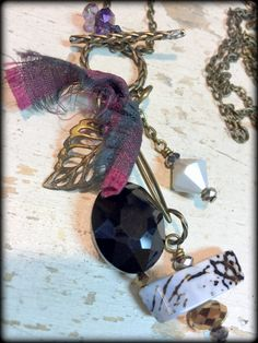 Agate, Crystal, Czech Glass, Fiber, Brass Charms at Char's Flying Fish Studio FB.