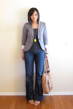 Cute for a casual Friday: gray blazer over dark T and trouser jeans, with neutral accessories and a pop of color