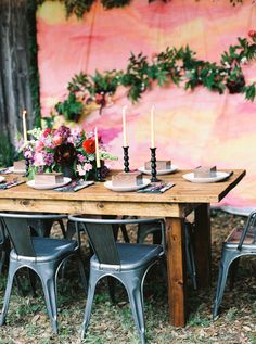 Use the greenery in back for table runner, get fake ones and then re use for the wedding