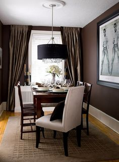 Dining room walls wrapped in a rich dark brown Designed  by Jane Lockhart