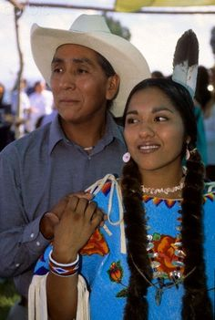 Native American family of Shoshone Bannock cowboy father with traditionally dressed daughter during an honoring ceremony on the Fort Hall Reservation, Idaho. Marilyn Angel Wynn photography