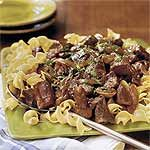 """Beef With Red Wine Sauce 3 lbs boneless beef chuck roast,cut in 1"""" pieces  1 med onion,slice 1 lb fresh mushrooms, halved 1 (1.61oz) pack brown gravy mix 1 (10 1/2oz) can beef broth 1 C red wine 2 tbsp tomato paste  1 bay leaf Hot cooked egg noodles or rice Garnish: chopped fresh parsley Place first 3 ingredients in 6-quart slow cooker. Whisk together gravy mix w next 3 ingredients;pour evenly over beef & vegetables.Add bay leaf. Cover,cook HIGH 6hr  Remove bay leaf.Serve over noodles…"""