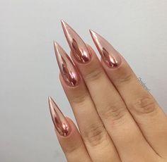 Sharp rose gold stiletto nails