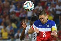 US forward Clint Dempsey goes up for a header against Ghana forward Asamoah Gyan (June 16, 2014).