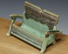 Handmade pottery business card holder with green and brown glazes