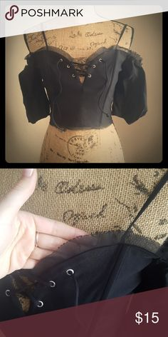 Black Corset Off-Shoulder Top This off-shoulder top with puff sleeves has never been worn. I bought it for something specifically but then changed my mind last minute. Great condition! Just noticed a small flaw in the chiffon. Picture above! Forever 21 Tops Crop Tops