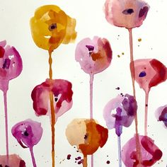 We made these lovely poppies by dribbling very watery watercolour blobs onto a vertical sheet of thick paper using a large brush - easy and fun :-)