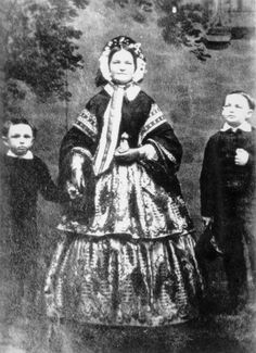 Mary Todd Lincoln with her sons, Willie and Tad, in 1860. Photograph by Preston Butler.