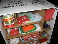 courtesy of TWO MEN AND A TRUCK Lansing.  Store your extra Christmas ribbons, Christmas wrappers and supplies using TWO MEN AND A TRUCK dish pack boxes that has the dish cell packs.