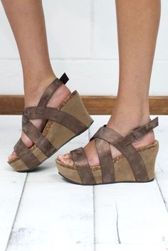 The sandal wedge of the season! This designer inspired (OTBT) look is super comfortable and features a strappy wrapped wedge. Metallic bronze in color. With the wedge and platform combo, these don't e