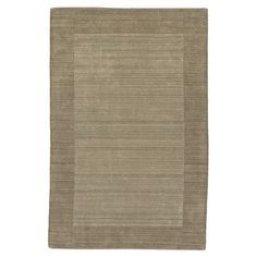 Wool rug hand-loomed in India.  Product: RugConstruction Material: 100% WoolColor: Taupe