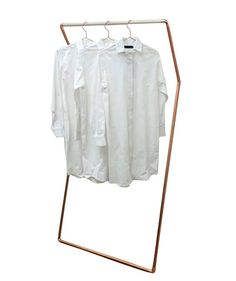 Minimalist design for a go-nearly-anywhere hanging rack. Set this angular copper-and-wood piece in the entryway to corral lightweight coats or keep it in the corner of a bedroom as a pseudo valet.