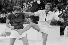 Peter Sellers, Roger Moore / photo by Terry O'Neill, Beverly Hills, 1970′s.