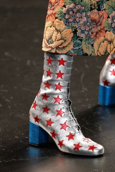 Hedi Slimane's otherwise bohemian Spring '14 menswear collection for Saint Laurent bore a handful of glam touches, like these Bowie-esque boots.