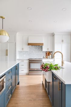 Farmhouse kitchen with beautiful blue cabinetry! Hibou Designs + Co.