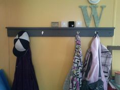 Diy coat rack with small picture ledge.