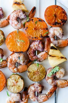 Grilled Shrimp Skewers in a red wine sangria marinade made with wine, orange liqueur, and citrus. Quick and easy these marinate while you wait for the grill to heat up— serve with steamed rice and a salad for a healthy dinner! #shrimp #shrimpskewers #grilledshrimp #healthydinner