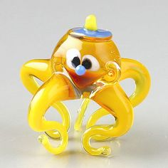 This Cute Yellow Octopus Glass Figurine is hand blown and imported from Russia. It's bright colors and adorable shape is sure to delight! Because each figurine is crafted by hand no two are exactly alike. Yellow Octopus, Blown Glass Art, Glass Figurines, Cute Little Things, Bright Colors, Cute Animals, Miniatures, Shapes, Christmas Ornaments