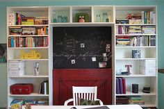 my office - Billy bookcases from IKEA, magnetic chalkboard wall & old barn door (more pics in the link)