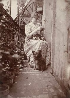 Ms Riviere, with dogs, 1896