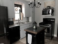 We used Valspar Cabinet paint from Lowes custom colored to the Home Depot Glidden paint color in Pebble Grey