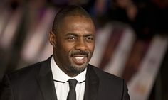 Idris Elba says he's still smiling after comments by James Bond author | Film | The Guardian