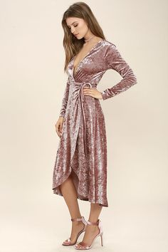 The Enchant Me Blush Velvet Midi Wrap Dress is bewitchingly beautiful! Crushed velvet is soft and stretchy across long sleeves and a wrapping surplice bodice, with a tying waist. Wrapped detail carries into a front slit midi skirt.