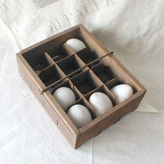 "1908 STAR EGG Carrier Tray Wood Box. Antique wooden STAR EGG CARRIER that is over 100 years old and comes with its original cardboard inserts for a dozen eggs. Rare size egg carrier with finger-jointed corners, sliding metal handle and printing on three sides. Measures approx. 8-1/4"" x 6-3/8"" x 2-3/4"" tall. Ref url: http://www.etsy.com/listing/76683690/1908-star-egg-carrier-tray-wood-box"