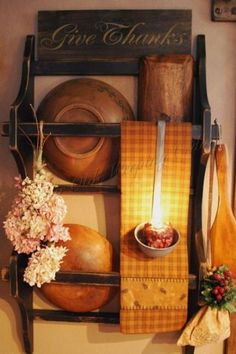 Prim wall rack...with old dough bowls...prim dipper with grubby votive.