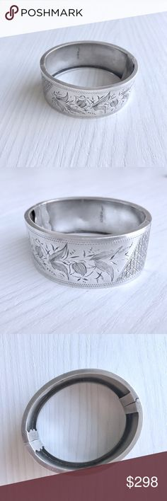Vintage Floral Motif Sterling Silver Cuff Etched with a romantic floral pattern, this vintage silver cuff is a rare find of true craftsmanship. Lightweight but substantial, it's sure to make a statement. Hinge opening with sliding latch. Measures 1.5 x 2 x 2.5 in. Very good condition. Vintage Jewelry Bracelets